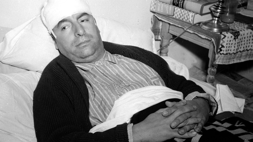 In this Dec. 1941 file photo, Pablo Neruda, Chilean consul-general in Mexico and famous Latin American poet, lies in a bed in Mexico City, recovering from injuries police said were inflicted by a group of German nationals in Cuernavaca the day before. (AP Photo, File)