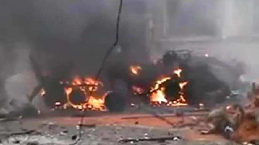 January 13, 2012: This image from amateur video made available by Ugarit News Group purports to show an armored personnel carrier in flames after it attacked protesters in Homs, Syria.