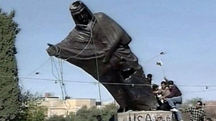 Kurds topple the statue of Saddam Hussein in Kirkuk, Northern Iraq in 2003.