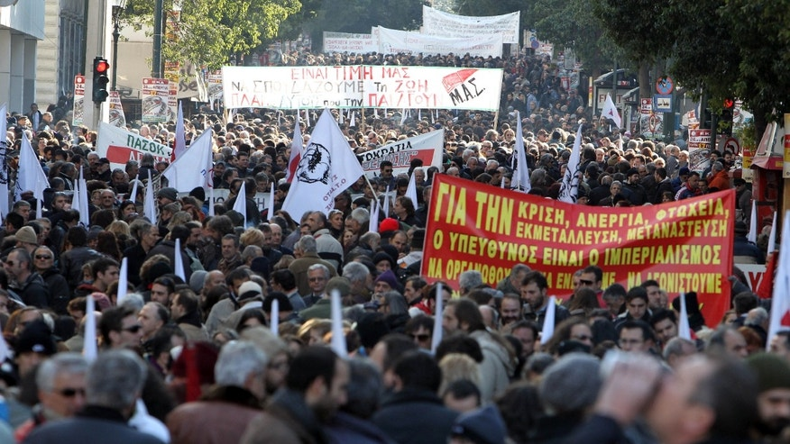 Jan. 17, 2012: Protesters take part in a rally organized by the PAME Communist-affiliated union as they hold banners with anti-austerity slogans in Athens.