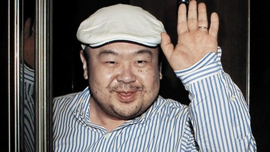 June 4: Kim Jong-nam, the eldest son of North Korean leader Kim Jong-il, waves to a South Korean reporter after his first-ever interview with South Korean media at a hotel in Macau.