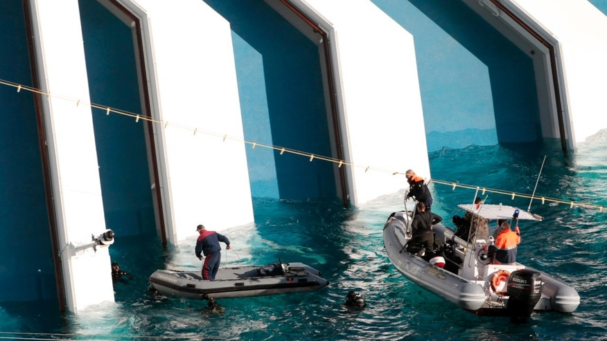Jan. 17, 2012: Italian naval divers approach the cruise ship Costa Concordia.