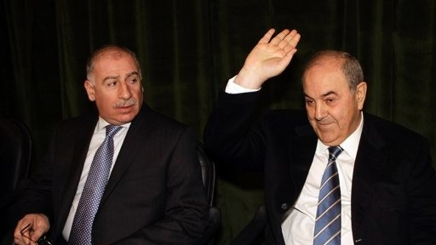 Jan. 18: Ayad Allawi, the leader of Iraq's main Sunni-backed and former Prime Minister, right, gestures as Iraq's Parliament Speaker Osama al-Nujaifi looks on during a meeting for the main Sunni-backed bloc in Baghdad, Iraq.
