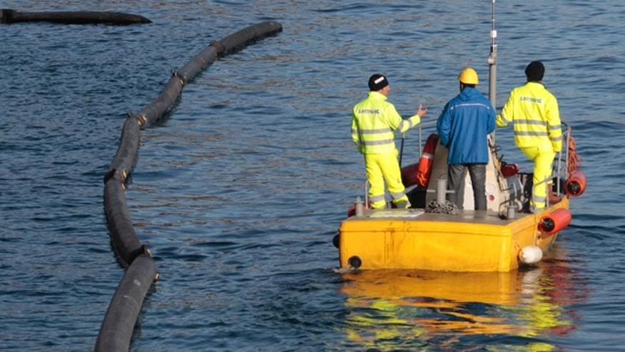 Jan. 21: Workers prepare their work of oil recovery from the cruise ship Costa Concordia off the Tuscan island off Giglio, Italy.