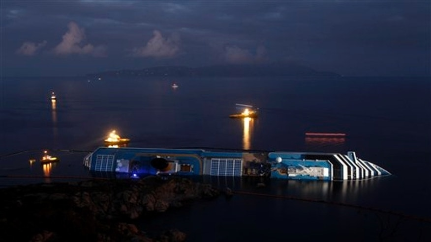 Jan. 23, 2012: The grounded cruise ship Costa Concordia lies on its side off the Tuscan island of Giglio, Italy.
