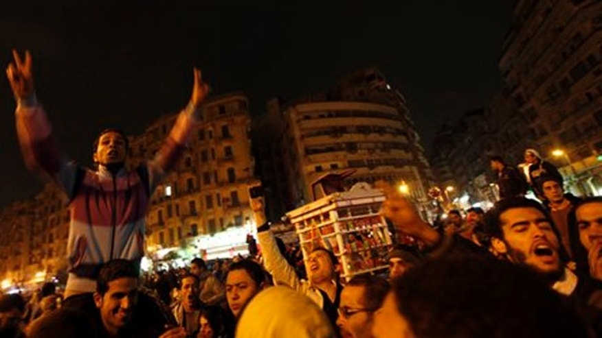 January 24, 2012: Egyptian protesters chant slogans while gathering at Tahrir Square in preparation to mark the first anniversary of the revolution Wednesday, in Cairo, Egypt.