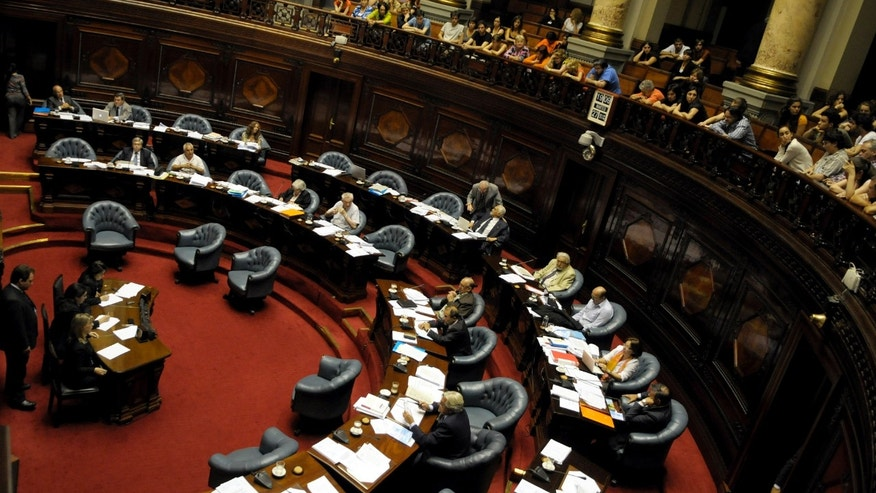 Members of the Uruguayan Senate attend a session in Montevideo, Uruguay, Tuesday Dec. 27, 2011. The Uruguayan Senate would approve a bill to decriminalize abortion, after an initiative vetoed by former President Vazquez in 2008. (AP Photo/Matilde Campodonico)