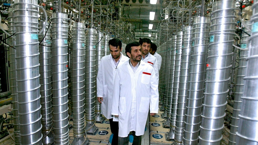 April 8, 2008: Iranian President Mahmoud Ahmadinejad, center, visits the Natanz Uranium Enrichment Facility some 200 miles (322 kilometers) south of the capital Tehran. Iran has begun uranium enrichment at a new underground site well protected from possible airstrikes, a leading hardline newspaper reported.