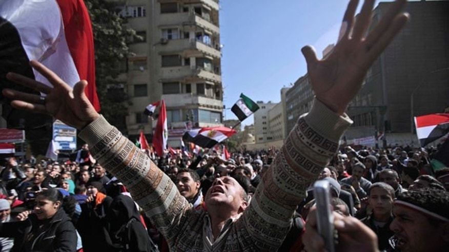 "Jan. 27, 2012: An Egyptian protestor chants slogans at a rally to mark the first anniversary of the ""Friday of Rage,"" in Tahrir Square, in Cairo, Egypt."
