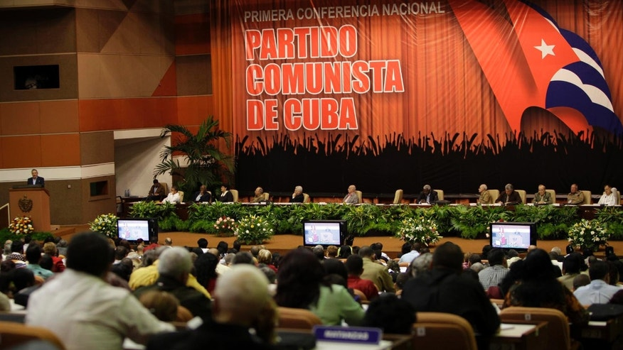 "Members of the Communist Party attend the closing ceremony of the Communist Party Conference in Havana, Cuba, Saturday, Jan. 29, 2012. Cuba's Communist leaders vowed not to cede any ground to ""the enemy,"" even as they pledged to fight corruption and continue overhauling the island's listing Marxist economy with an injection of free market reform.(AP Photo/Ismael Francisco, Prensa Latina)"
