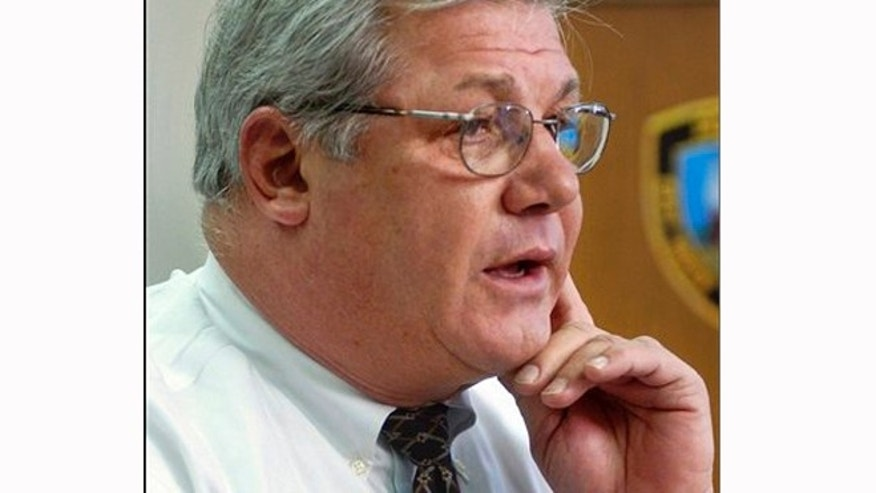 FILE -Chief Leonard Gallo talks with reporters at the East Haven, Conn., police station in 2006.
