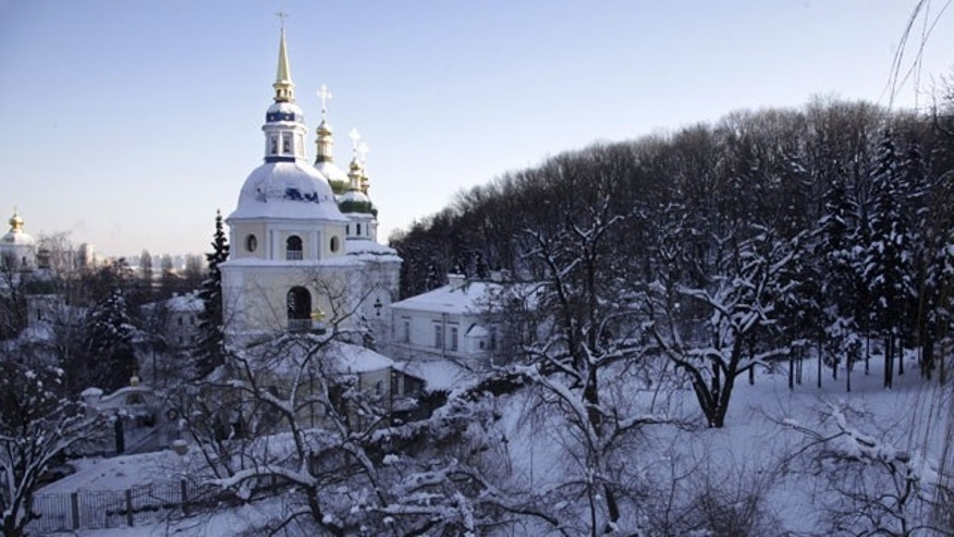 January 30, 2012: An Orthodox Christian cathedral in winter landscape in Kiev, Ukraine. Ukraine's Emergency Situations Ministry said 18 people died of hypothermia and nearly 500 people sought medical help for frostbites and hypothermia in just three days last week.