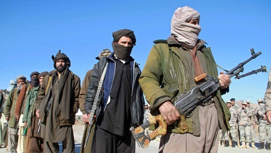 January 30, 2012: Taliban militants hand over their weapons after joining the Afghan government's reconciliation and reintegration program, in Heart.