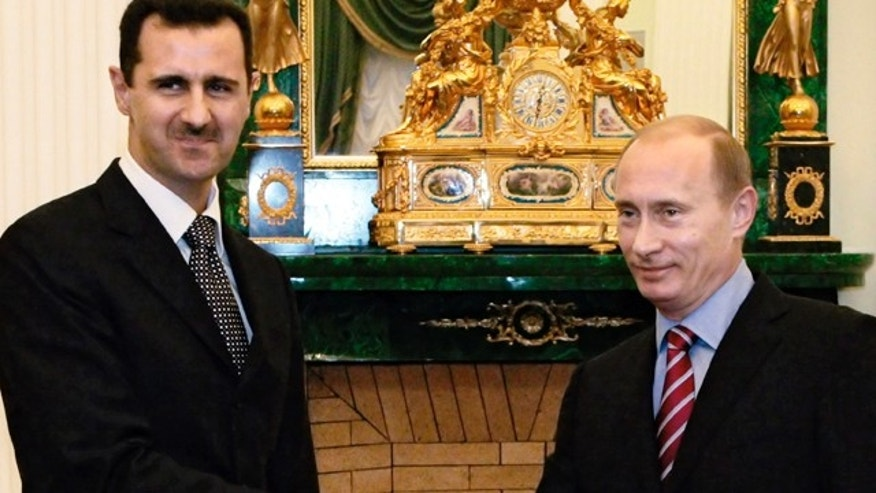 FILE 2006: Vladimir Putin, then Russian president, right, and his Syrian counterpart Bashar Assad meet at the Kremlin.