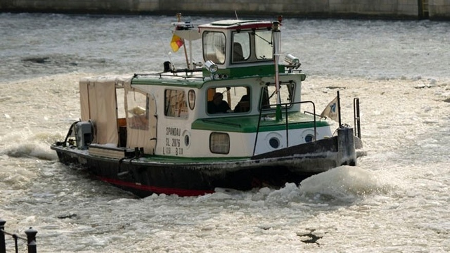 Feb. 3, 2012: A boat makes its way on the frozen river Spree in Berlin. After a warm January, Germany was hit by a cold snap with temperatures far below the freezing point.