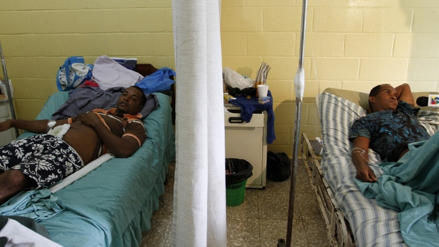 Survivors lie on their beds at the Elupina Cordero Hospital in Sabana de la Mar,  Dominican Republic, Sunday Feb. 5,  2012. According to authorities 15 bodies have been recovered after an overloaded boat carrying migrants from the Dominican Republic overturned in the pre-dawn darkness Saturday off the coast of the Dominican Republic. (AP Photo/str)
