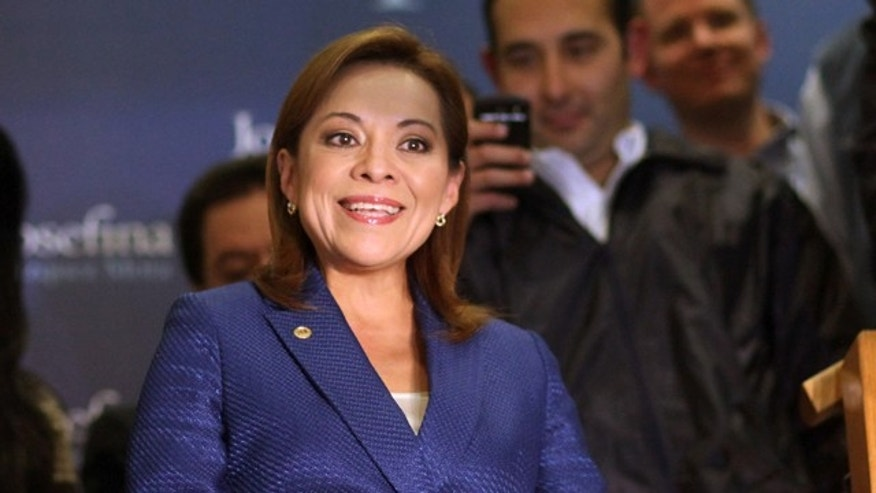Feb. 5, 2012: Former congresswoman Josefina Vazquez Mota, front, speaks to journalists and supporters prior to know about her party's primary elections final results in Mexico City.