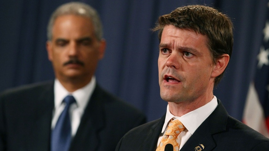 Director of U.S. Immigration and Customs Enforcement, John Morton (R), and Attorney General Eric Holder participate in a news conference. (Photo by Mark Wilson/Getty Images)