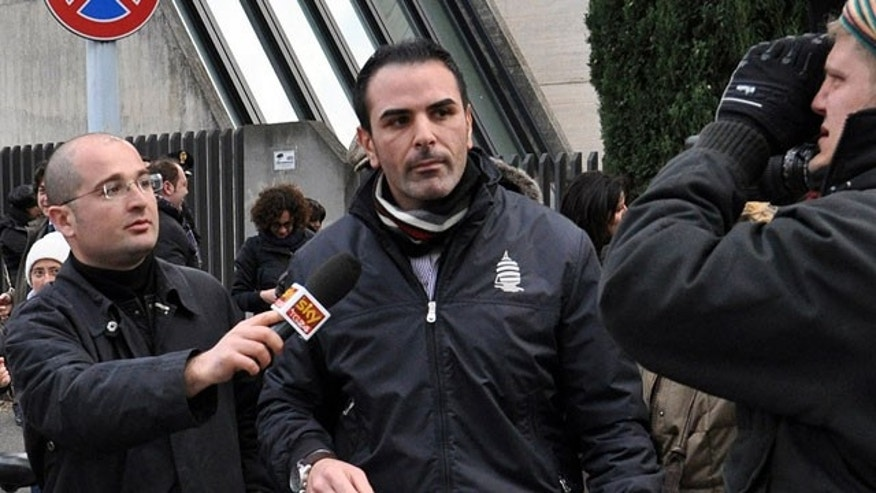 Jan. 27, 2012: Costa Concordia cruise ship first officer Ciro Ambrosio, center, leaves the prosecutor's office after being heard in regard to the cruise ship's grounding off the Tuscan island of Giglio in Grosseto, Italy.