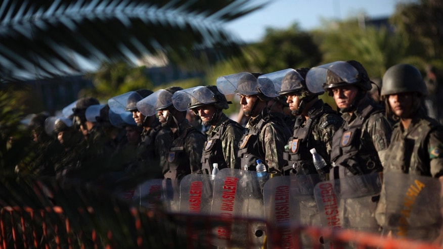 Soldiers maintain their blockade of the Bahian state legislature building, where up to 300 striking police officers and their families are holed up, in Salvador, Brazil, Tuesday Feb. 7, 2012. (AP Photo/Felipe Dana)