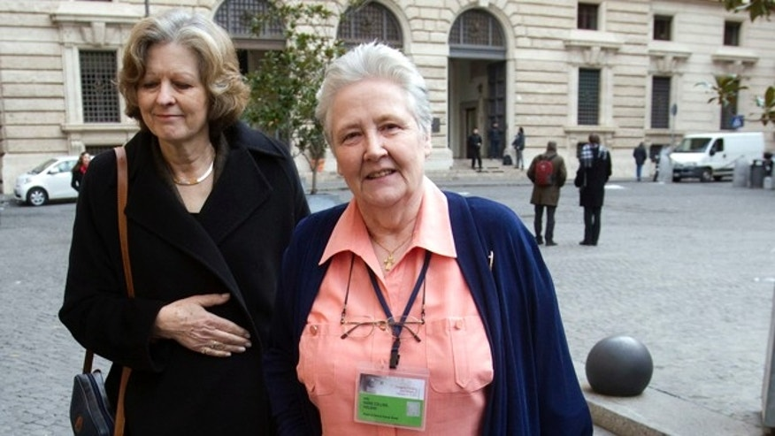 Feb. 7, 2012- Marie Collins, right  who was allegedly assaulted as a 13-year-old by a hospital chaplain in her native Ireland, is flanked by British psychiatry professor Sheila Hollins, as they arrive at a Vatican-backed symposium on clerical sex abuse, in Rome.