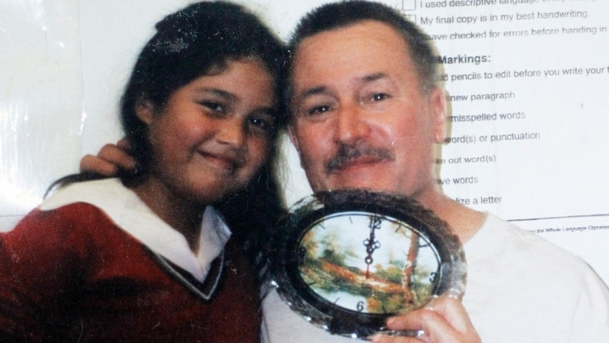 This 2003 photo provided by Flor Cervantes shows former Miramonte Elementary teacher Mark Berndt with her sister, Angelica Zuniga, then a third-grader, at the school in Los Angeles.
