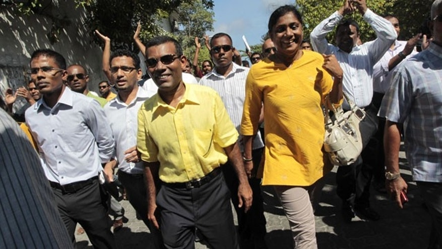 Feb. 8, 2012: Mohamed Nasheed, yellow shirt front center, who resigned Tuesday from his post as Maldivian President, marches along with his supporters during a rally in Male, Maldives.
