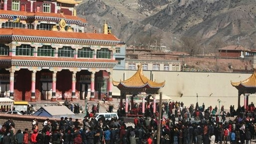 Feb. 8: Hundreds of Tibetans gather on the side of a main street in Nangqian county, China's Qinghai province.