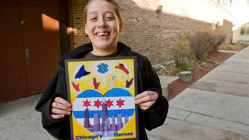Herbert Pulgar, 15, holding his winning design for the 2012-13 city of Chicago vehicle sticker that was axed by Chicago City Clerk Susana Mendoza contending some may believe it depicts street gang signs.
