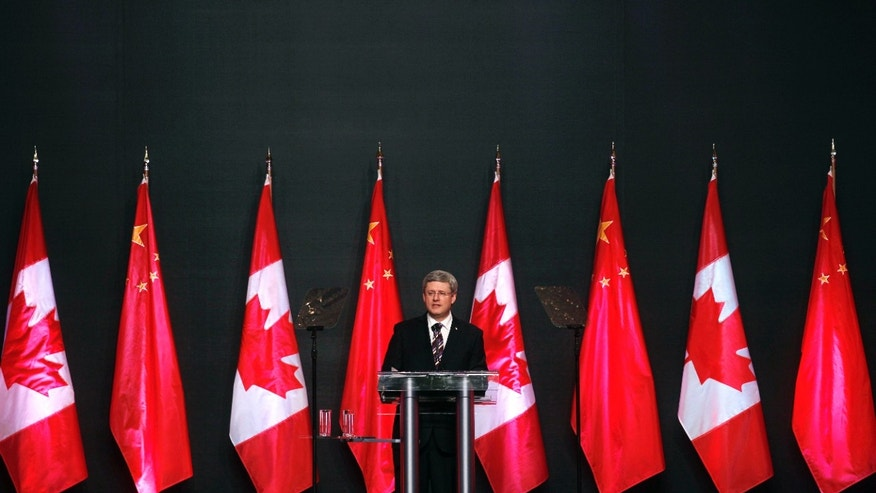 Feb. 10, 2012: Canadian Prime Minister Stephen Harper delivers his speech in Guangzhou, China.