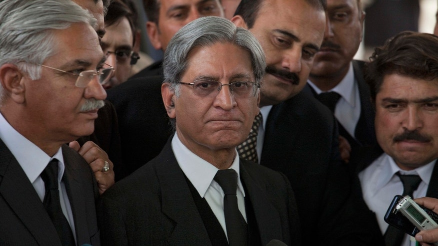 Feb. 2, 2012: Aitzaz Ahsan, center, lawyer of Pakistan's Prime Minister Yusuf Raza Gilani listens to reporters outside the Supreme Court in Islamabad, Pakistan.