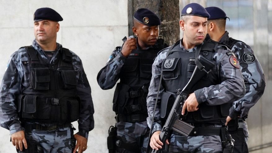 Feb. 10, 2012: Police officers stand at their headquarters in Rio de Janeiro, Brazil.