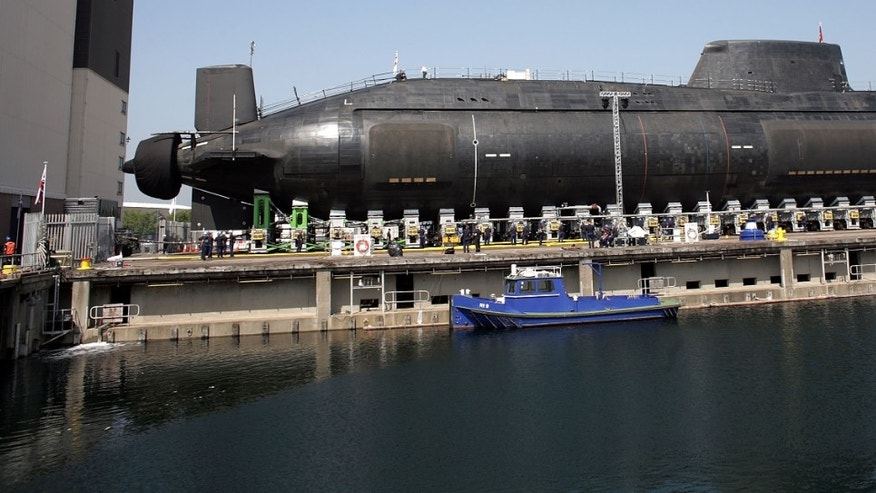 BARROW-IN-FURNESS, UNITED KINGDOM - JUNE 08:  The new Royal Navy submarine HMS Astute emerges from it's berth after being launched by Camilla, Duchess of Cornwall at the BAES shipyard on June 8, 2007 in Barrow-in-Furness, United Kingdom. Astute is the first nuclear submarine to be launched in the UK for almost a decade. The submarine will be equipped with advanced cruise missiles and torpedoes, giving it more firepower than any previous British attack submarine. The advanced on-board life support systems enables the submarine to circumnavigate the globe without needing to surface. The vessel will start service with the Royal Navy in 2009.  (Photo by Christopher Furlong/Getty Images)