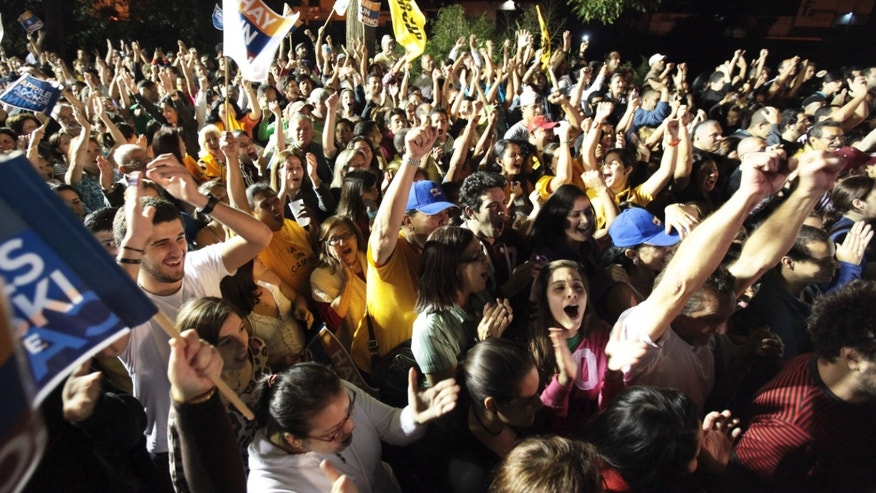 Supporters of Henrique Capriles celebrate after he won the opposition presidential primary election  in Caracas, Venezuela, on Sunday, Feb. 12, 2012. (AP Photo/Fernando Llano)
