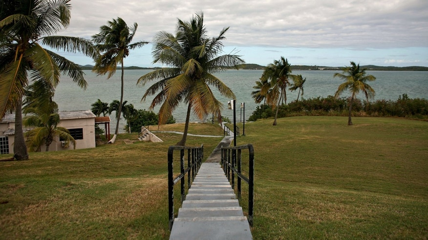 In this photo taken on Jan. 25, a walkway leads to the shore from inside the former Naval Station Roosevelt Roads in Ceiba, Puerto Rico. (AP Photo/Ricardo Arduengo)
