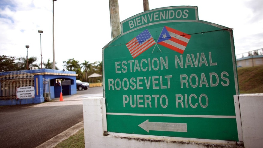 In this photo taken on Jan. 25, a welcome sign stands at the entrance of the former Naval Station Roosevelt Roads in Ceiba, Puerto Rico. (AP Photo/Ricardo Arduengo)