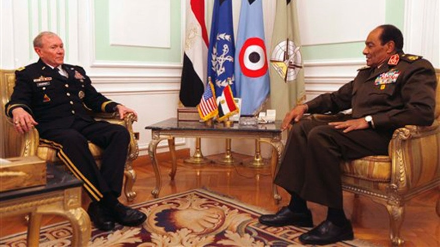 Feb. 11, 2012: Chairman of the Joint Chiefs of Staff Gen. Martin Dempsey, left, meets with Field Marshal Mohamed Hussein Tantawi, head of Egypt's ruling military council, right, at the Ministry of Defense in Cairo.