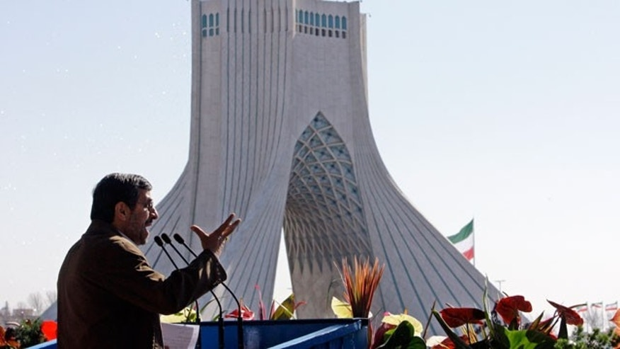 Feb. 11, 2012: Iranian President Mahmoud Ahmadinejad gestures as he deliver his speech near the Azadi (freedom) tower at a rally to mark the 33rd anniversary of the Islamic Revolution that toppled the country's pro-Western monarchy and brought Islamic clerics to power, Tehran.