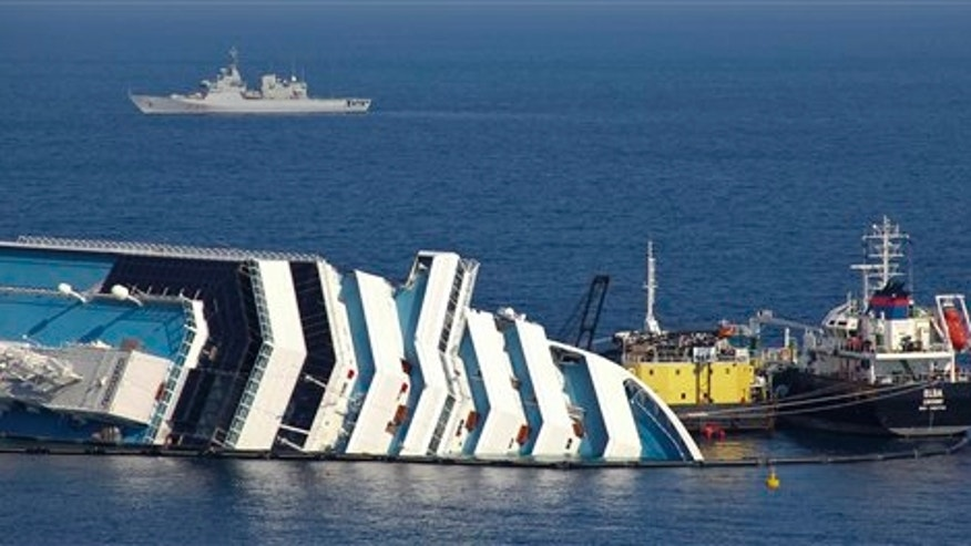 Feb. 13: Ongoing operations to remove fuel from the half sunken hulk of the luxury ship Costa Concordia a month after it ran aground are seen outside the port of Isola del Giglio island in Tuscany, Italy.