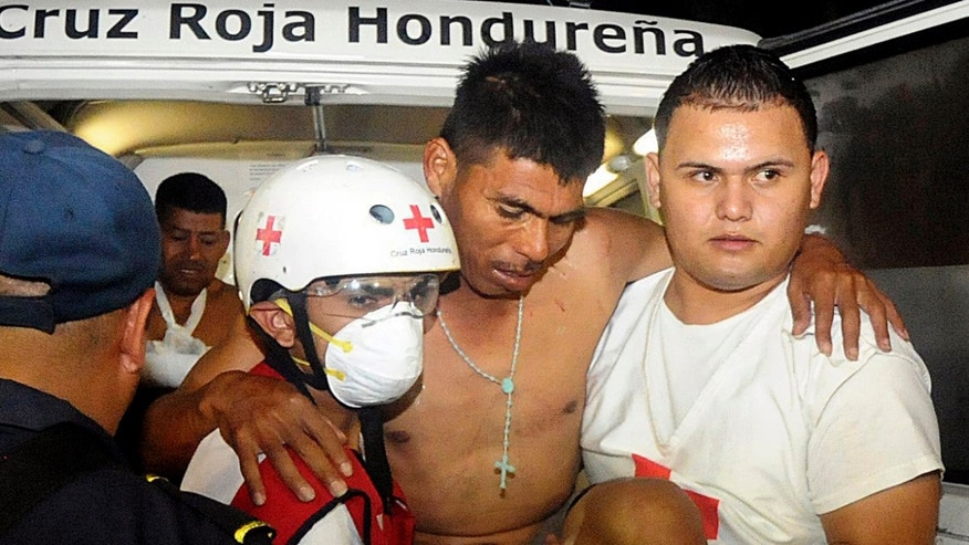 An injured inmate is carried as he arrives at the hospital after a fire broke out at the prison in Comayagua, Honduras, a town 90 miles (140 kilometers) north of the Central American country's capital, Tegucigalpa, early Wednesday, Feb. 15, 2012.  Radio reports from Comayagua said dozens of prisoners were burned beyond recognition and the prison was destroyed by the flames.  The fire claimed the lives of at least 272 inmates. (AP Photo/Fernando Antonio)