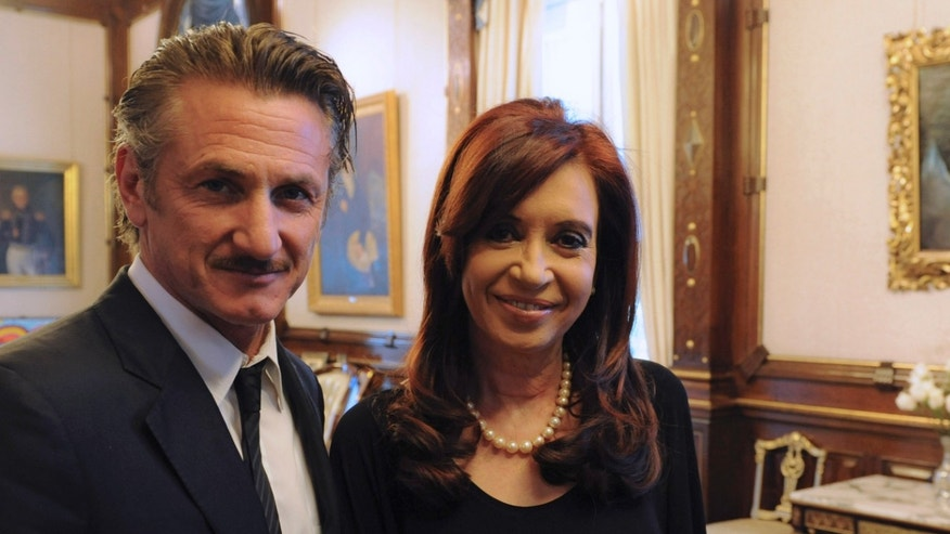 "In this picture released by Argentina's Presidency, President Cristina Fernandez poses with actor Sean Penn at government palace in Buenos Aires, Argentina, Monday Feb. 13, 2012. Penn, who is taking Argentina's side in the Falkland Islands dispute, urged Britain to join U.N.-sponsored talks over what he called ""the Malvinas Islands of Argentina."" (AP Photo/Argentina's Presidency)"