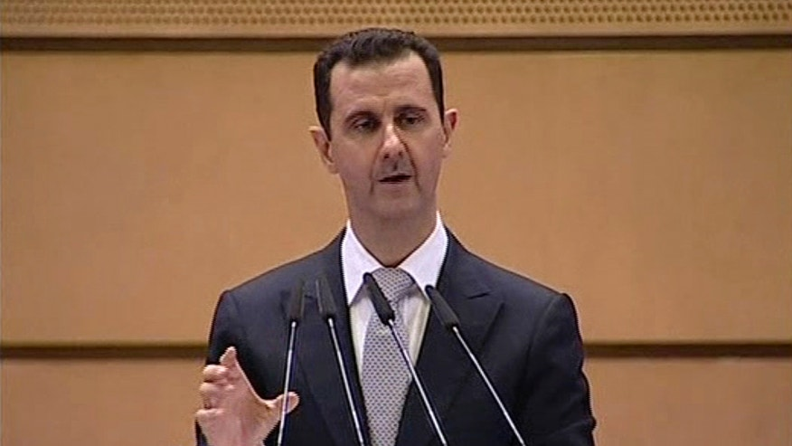 Jan. 10, 2012: Syrian President Bashar Assad delivers a speech in Damascus, Syria.