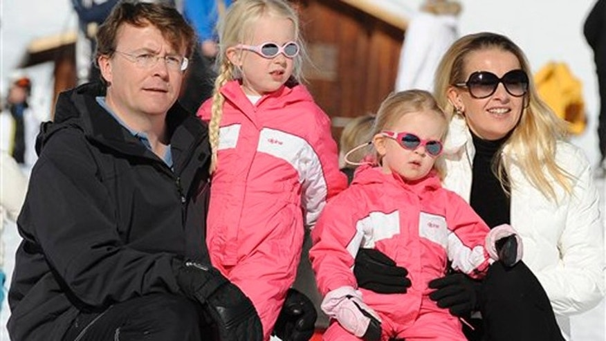 Feb. 19, 2011: In this file photo Netherland's Prince Friso, left, and his wife Princess Mabel, right, pose with their daughters Luana and Zaria for photographers during a photo session in the Austrian skiing resort of Lech.