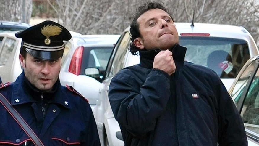 Jan. 14: Francesco Schettino, right, the captain of the luxury cruiser Costa Concordia, which ran aground off Italy's tiny Tuscan island of Isola del Giglio.
