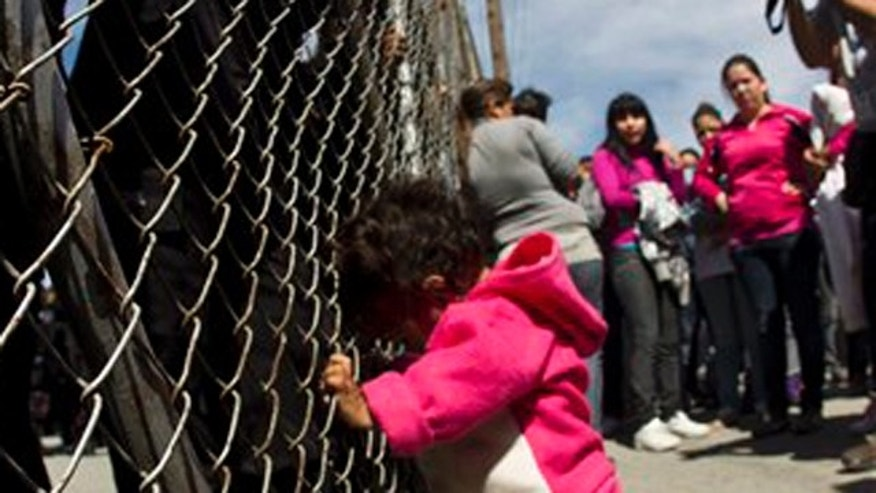 Feb. 19, 2012: A child yells out for her father as she pushes on a gate where police stand on the other side after her mother and other adults pushed the gates in an attempt to get past state police at the Apodaca correctional state facility in Apodaca on the outskirts of Monterrey, Mexico.
