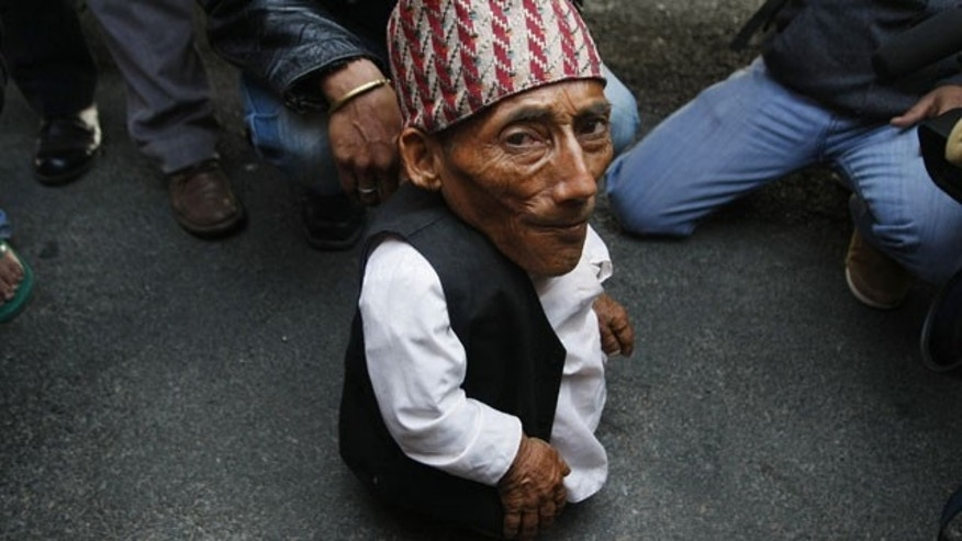 Feb. 22, 2012: Nepalese Chandra Bahadur Dangi, 72, who says he's only 22 inches (56 centimeters) tall arrives at the airport in Katmandu, Nepal.