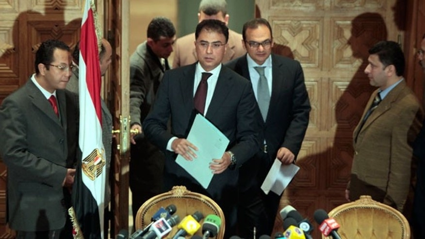Feb. 8, 2012: Egyptian investigative judges Sameh Abu Zeid, right, and Ashraf el-Ashmawi, who are investigating the case of foreign funding of NGOs, enter a press conference at the Ministry of Justice in Cairo, Egypt.
