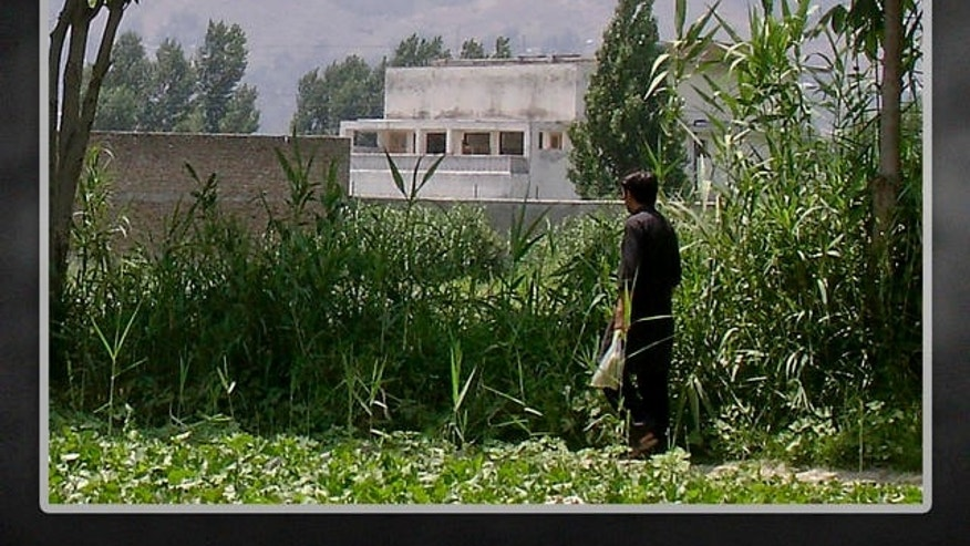 FILE: A local residents walks near a house where Al Qaeda leader Usama bin Laden was killed, Abbottabad, Pakistan.