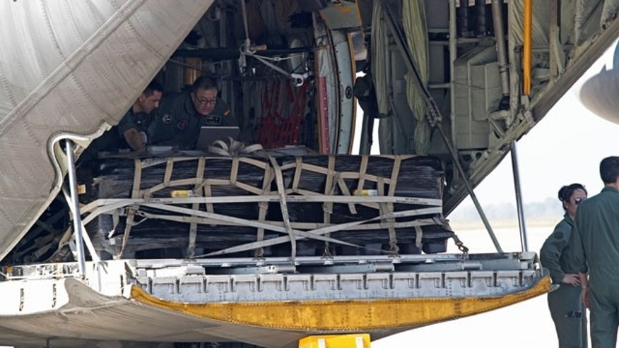 Feb. 24, 2012: Officials from the government of Spain load two Spanish military C-130 aircraft with 17 tons of silver and other artifacts at MacDill Air Force Base for a flight bound for Spain.