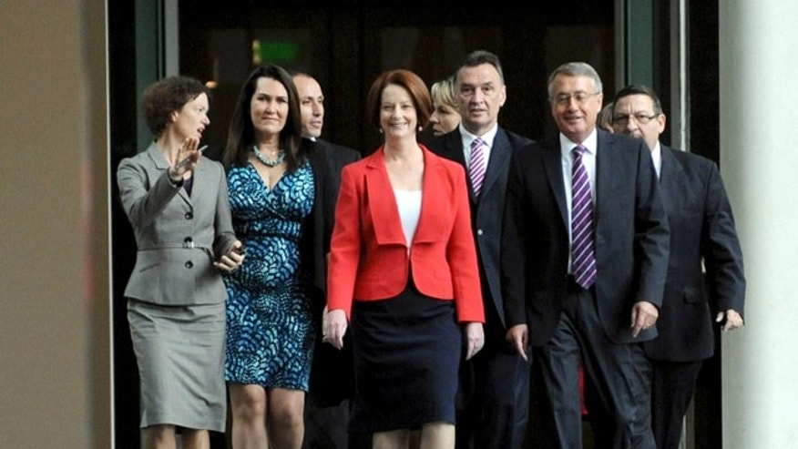 Feb. 27, 2012: Australian Prime Minister Julia Gillard, center, with supporters for the caucus meeting walks through the parliament house in Canberra, Australia.